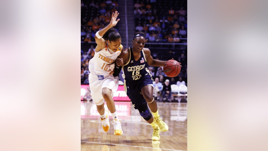 Georgia Tech guard Tyaunna Marshall (15) drives against Tennessee guard Meighan Simmons (10) in the first half of an NCAA college basketball game on Sunday, Nov. 17, 2013, in Knoxville, Tenn. (AP Photo/Wade Payne)