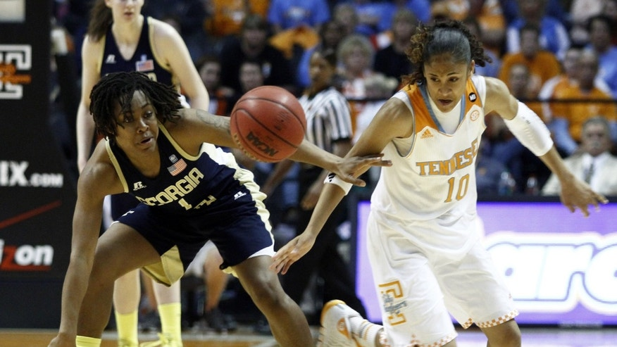 Tennessee guard Meighan Simmons, right, knocks the away from Georgia Tech guard Dawnn Maye (1) in the seond half of an NCAA college basketball game on Sunday, Nov. 17, 2013, in Knoxville, Tenn. Tennessee won 87-76. (AP Photo/Wade Payne)