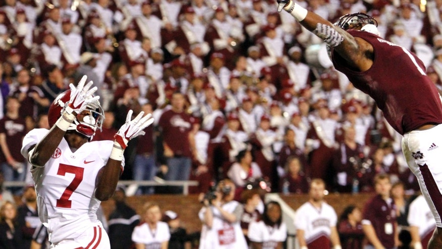 Mississippi State defensive back Nickoe Whitley (1) breaks up a pass intended for Alabama wide receiver Kenny Bell (7) in the end zone during the second half of an NCAA college football game on Saturday, Nov. 16, 2013, in Starkville, Miss. (AP Photo/Butch Dill)