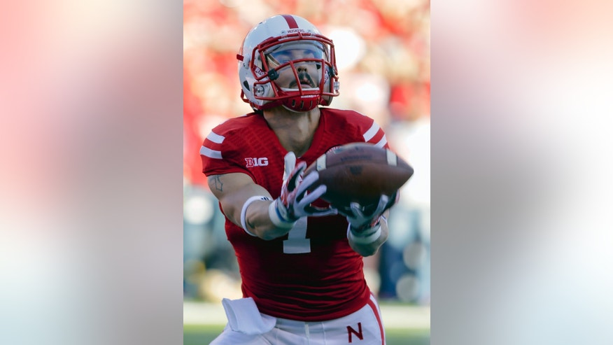 Nebraska wide receiver Jordan Westerkamp (1) fumbles a kickoff ball for a turnover in the first half of an NCAA college football game against Michigan State in Lincoln, Neb., Saturday, Nov. 16, 2013. (AP Photo/Nati Harnik)