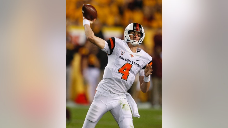 Oregon Statequarterback Sean Mannion (4) throws against Arizona State during the first half of an NCAA college football game on Saturday, Nov. 16, 2013, in Tempe, Ariz. (AP Photo/Rick Scuteri)