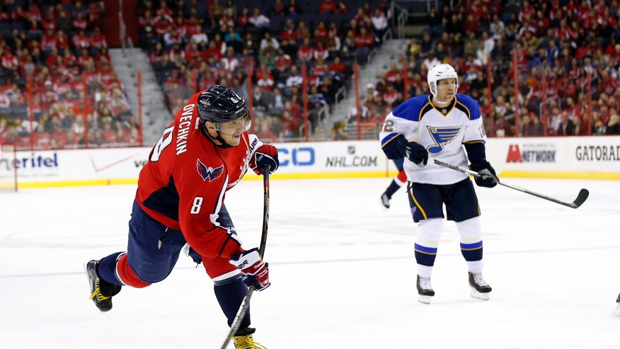Washington Capitals right wing Alex Ovechkin (8), of Russia, shoots his first goal with St. Louis Blues center Derek Roy (12) at right, in the first period of an NHL hockey game, Sunday, Nov. 17, 2013, in Washington. (AP Photo/Alex Brandon)