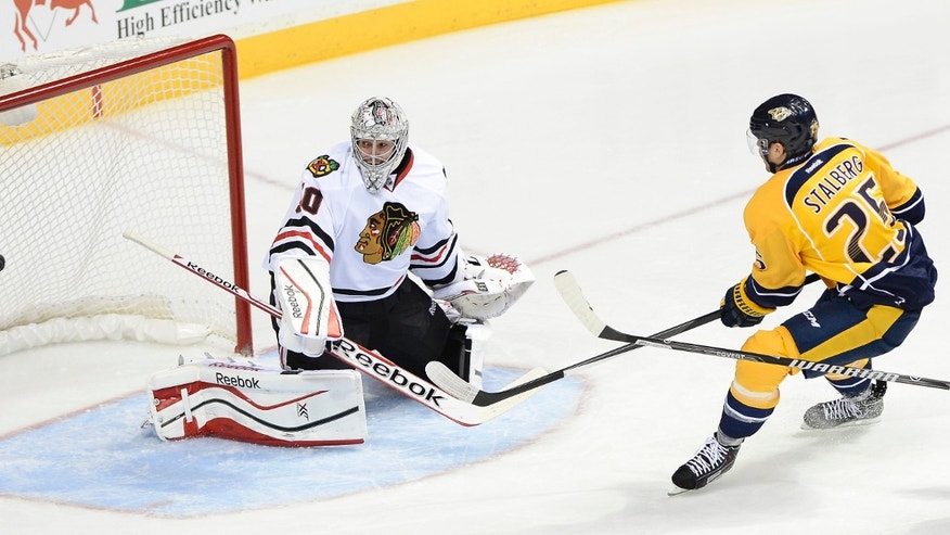 Chicago Blackhawks goalie Corey Crawford (50) turns away a shot by Nashville Predators forward Viktor Stalberg (25), of Sweden, during the second period of an NHL hockey game Saturday, Nov. 16, 2013, in Nashville, Tenn. (AP Photo/Mark Zaleski)