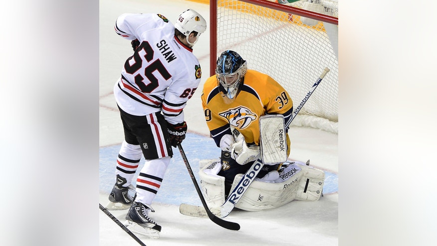 Nashville Predators goalie Marek Mazanec (39),, of the Czech Republic, blocks a shot by Chicago Blackhawks center Andrew Shaw during the second period of an NHL hockey game Saturday, Nov. 16, 2013, in Nashville, Tenn. (AP Photo/Mark Zaleski)