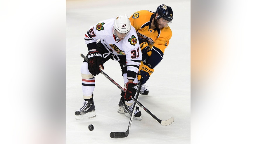 Chicago Blackhawks forward Brandon Pirri (37) and Nashville Predators forward Matt Cullen (7) fight to gain control of the puck in the second period of an NHL hockey game Saturday, Nov. 16, 2013, in Nashville, Tenn. (AP Photo/Mark Zaleski)