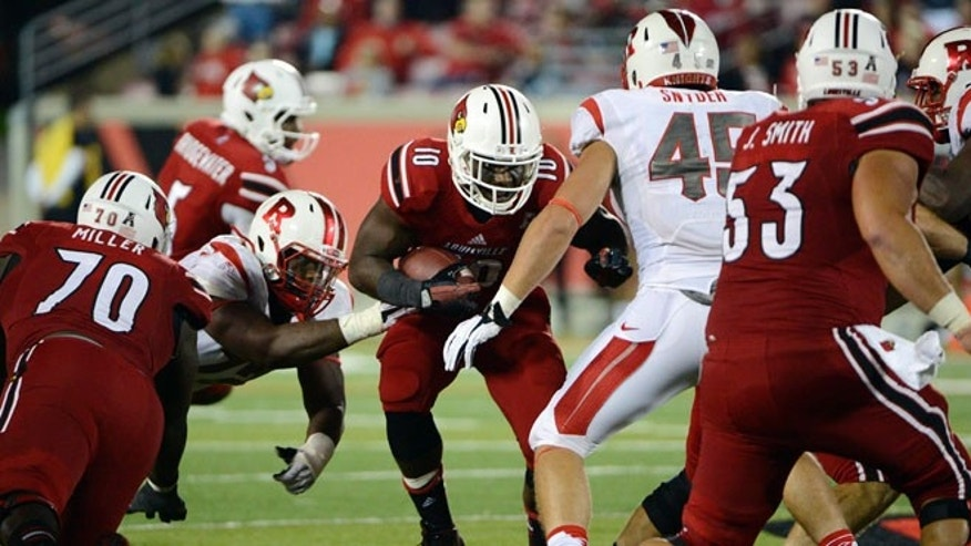 Oct 10, 2013;Louisville Cardinals running back Dominique Brown (10) runs the ball against Rutgers Scarlet Knights linebacker Kevin Snyder (45) during the second half at Papa John's Cardinal Stadium.
