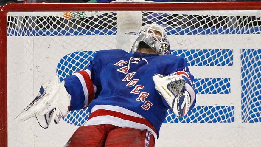 New York Rangers goalie Henrik Lundqvist (30) of Sweden reacts after Los Angeles Kings center Tyler Toffoli (73) scored a goal in the second period of their NHL hockey game at Madison Square Garden in New York, Sunday, Nov. 17, 2013.  (AP Photo/Kathy Willens)