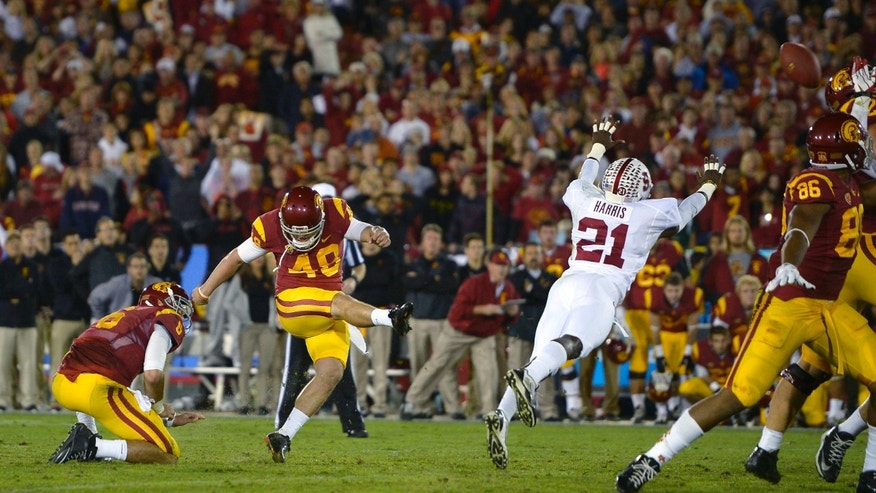 Southern California's Andre Heidari, center, kicks the game-winning field goal as Stanford defensive back Ronnie Harris, right, tries to block while quarterback Cody Kessler holds during the second half of an NCAA college football game, Saturday, Nov. 16, 2013, in Los Angeles. USC won 20-17. (AP Photo/Mark J. Terrill)