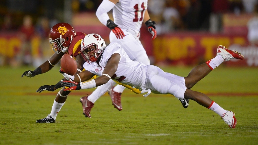 Stanford cornerback Wayne Lyons, right, almost intercepts a pass intended for Southern California wide receiver Nelson Agholor during the first half of an NCAA college football game, Saturday, Nov. 16, 2013, in Los Angeles. (AP Photo/Mark J. Terrill)