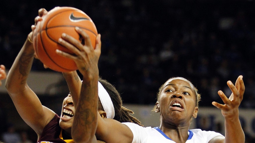 Kentucky's DeNesha Stallworth (11) and Central Michigan's Crystal Bradford (23) fight for a rebound during the first half of an NCAA basketball game, Sunday, Nov. 17, 2013, in Lexington, Ky. (AP Photo/James Crisp)