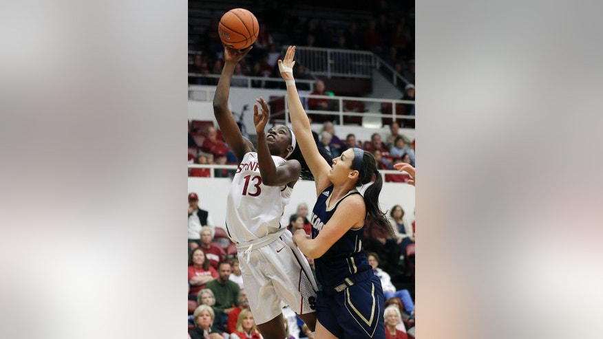 Stanford forward Chiney Ogwumike (13) shoots against UC Davis forward Alyson Doherty during the first half of an NCAA college basketball game in Stanford, Calif., Sunday, Nov. 17, 2013. (AP Photo/Jeff Chiu)