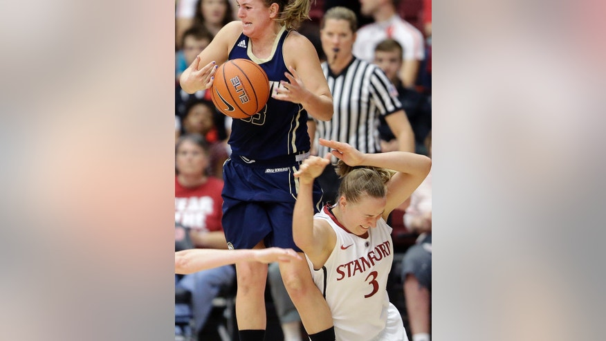 UC Davis guard Kelsey Harris, left, tries to control the ball over Stanford forward Mikaela Ruef (3) during the first half of an NCAA college basketball game in Stanford, Calif., Sunday, Nov. 17, 2013. (AP Photo/Jeff Chiu)