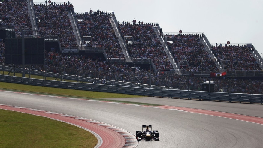 Red Bull driver Sebastian Vettel of Germany races during the Formula One U.S. Grand Prix auto race at the Circuit of the Americas, Sunday, Nov. 17, 2013, in Austin, Texas. (AP Photo/David J. Phillip)