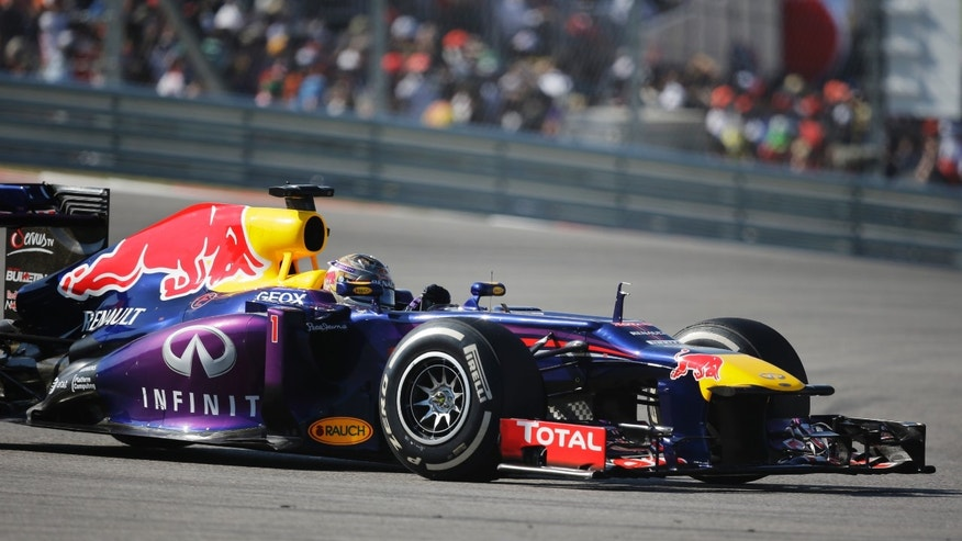 Red Bull driver Sebastian Vettel of Germany races during the Formula One U.S. Grand Prix auto race at the Circuit of the Americas, Sunday, Nov. 17, 2013, in Austin, Texas. (AP Photo/Eric Gay)