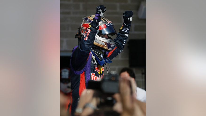 Red Bull driver Sebastian Vettel of Germany celebrates after winning the Formula One U.S. Grand Prix auto race at the Circuit of the Americas, Sunday, Nov. 17, 2013, in Austin, Texas. (AP Photo/Darron Cummings)