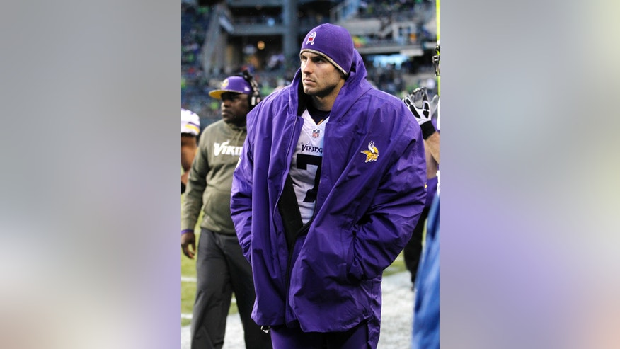 Minnesota Vikings quarterback Christian Ponder walks along the sidelines late in the second half of an NFL football game against the Seattle Seahawks, Sunday, Nov. 17, 2013, in Seattle. (AP Photo/John Froschauer)