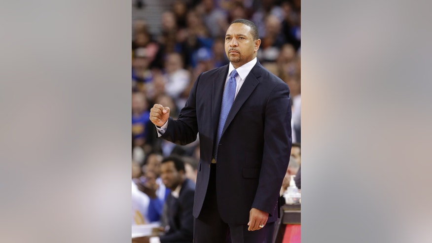 Golden State Warriors head coach Mark Jackson reacts after the team scored against the Utah Jazz during the second quarter of an NBA basketball game in Oakland, Calif., Saturday, Nov. 16, 2013. (AP Photo/Jeff Chiu)