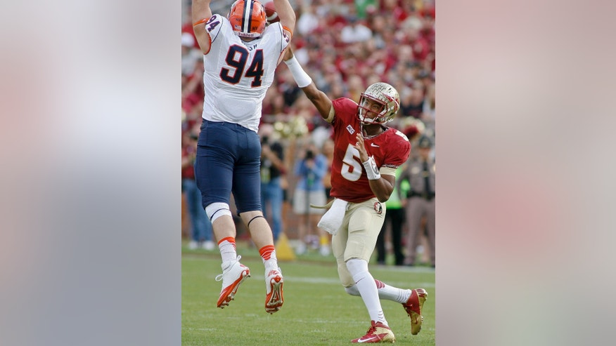 Florida State quarterback Jameis Winston (5) gets off a pass as Syracuse defensive end Robert Welsh (94) attempts to block it in the first quarter of an NCAA college football game on Saturday, Nov. 16, 2013, in Tallahassee, Fla. (AP Photo/Phil Sears)