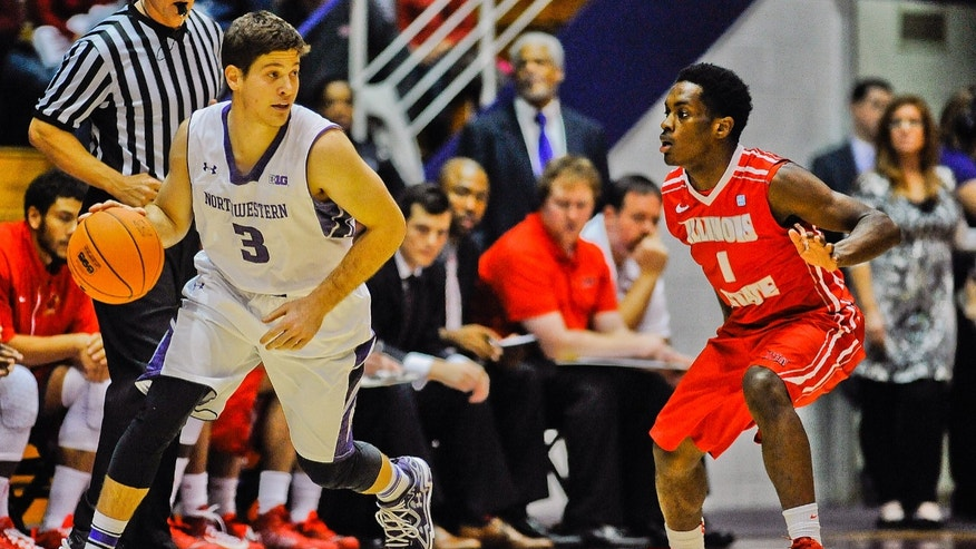 Northwestern's Dave Sobolewski, left, dribbles near Illinois State's Paris Lee during the first half of an NCAA college basketball game in Evanston, Ill., on Sunday, Nov. 17, 2013. (AP Photo/Matt Marton)