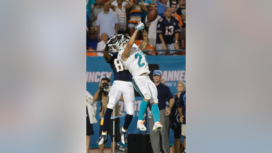 Miami Dolphins cornerback Brent Grimes (21) defends San Diego Chargers wide receiver Vincent Brown (86) during the second half of an NFL football game, Sunday, Nov. 17, 2013, in Miami Gardens, Fla. The Dolphins defeated the Chargers 20-16. (AP Photo/Wilfredo Lee)