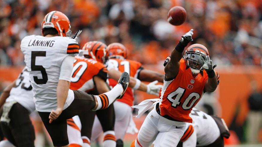 Cincinnati Bengals strong safety Shawn Williams (40) blocks a second-quarter punt by Cleveland Browns' Spencer Lanning (5) during an NFL football game in Cincinnati, Sunday, Nov. 17, 2013. (AP Photo/The Enquirer, Jeff Swinger) NO SALES; MAGAZINES OUT