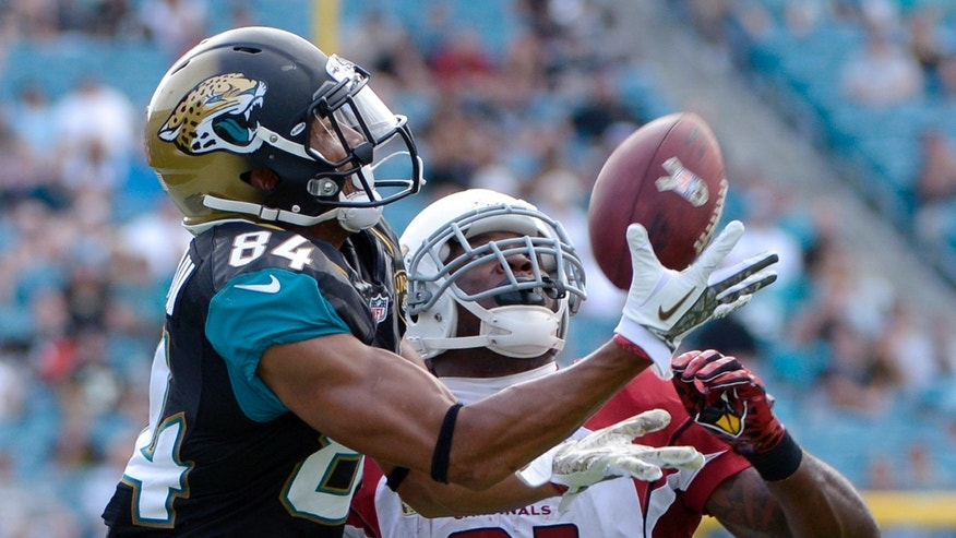 Jacksonville Jaguars wide receiver Cecil Shorts (84) catches a pass in front of Arizona Cardinals cornerback Patrick Peterson (21) but was ruled out of bounds in the second half of an NFL football game in Jacksonville, Fla., Sunday, Nov. 17, 2013. Arizona defeated Jacksonville 27-14. (AP Photo/Phelan M. Ebenhack)