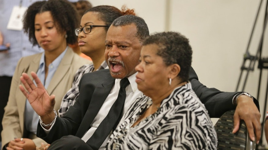 Virginia State University alumni, Herbert Johnson, second from right, express concerns during a press conference at Norfolk State University in  Petersburg, Va., Monday, Nov. 18, 2013. School officials held the press conference to answer questions after Winston-Salem quarterback Rudy Johnson was beaten in a bathroom brawl Friday, Nov. 15 that led to VSU being banned from post season play.  (AP Photo/Steve Helber)