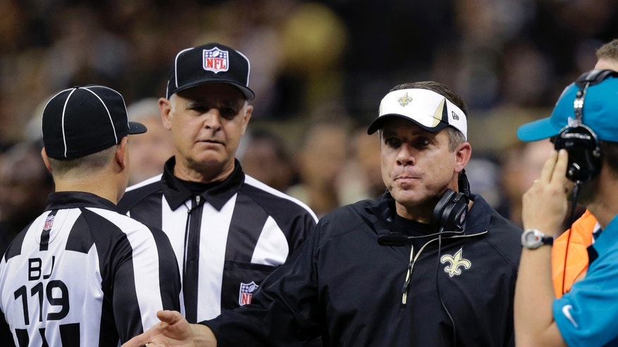 New Orleans Saints head coach Sean Payton challenges the officials in the first half of an NFL football game against the San Francisco 49ers in New Orleans, Sunday, Nov. 17, 2013. (AP Photo/Bill Haber)