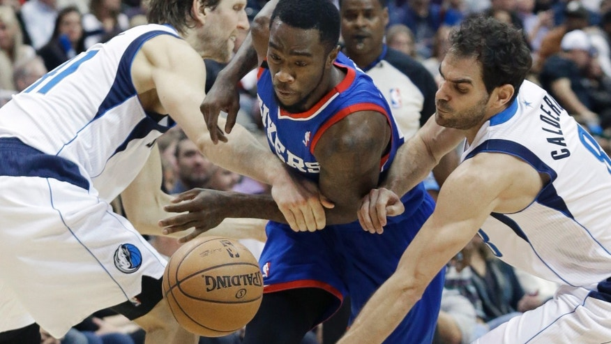 Philadelphia 76ers guard Tony Wroten (8) drives between Dallas Mavericks forward Dirk Nowitzki (41) of Germany and guard Jose Calderon (8) of Spain during the first half of an NBA basketball game in Dallas,  Monday, Nov. 18, 2013. (AP Photo/LM Otero)