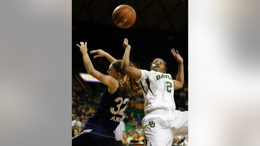 Rice forward Alyssa Lang (32) and Baylor's Niya Johnson (2) collide competing for a rebound in the first half of an NCAA college basketball game, Monday, Nov. 18, 2013, in Waco, Texas. (AP Photo/Tony Gutierrez)