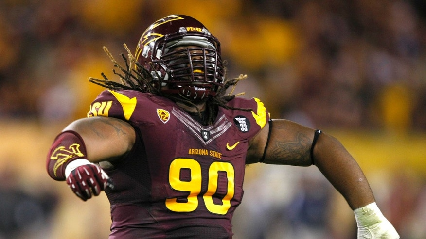Arizona State defensive tackle Will Sutton (90) celebrates during the first half of an NCAA college football game against Oregon State after a turnover on Saturday, Nov. 16, 2013, in Tempe, Ariz. (AP Photo/Rick Scuteri)
