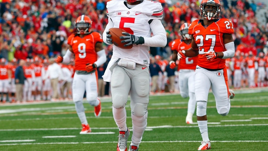 Ohio State quarterback Braxton Miller (5) scores on a 70-yard touchdown run as Illinois defensive back Eaton Spence (27) and defensive back Earnest Thomas III (9) chase him during the first half of an NCAA college football game on Saturday, Nov. 16, 2013, in Champaign, Ill. (AP Photo/Jeff Haynes)