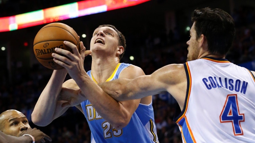 Denver Nuggets center Timofey Mozqov (25) is fouled by Oklahoma City Thunder power forward Nick Collison (4) in the second quarter of an NBA basketball game in Oklahoma City, Monday, Nov. 18, 2013. (AP Photo/Sue Ogrocki)