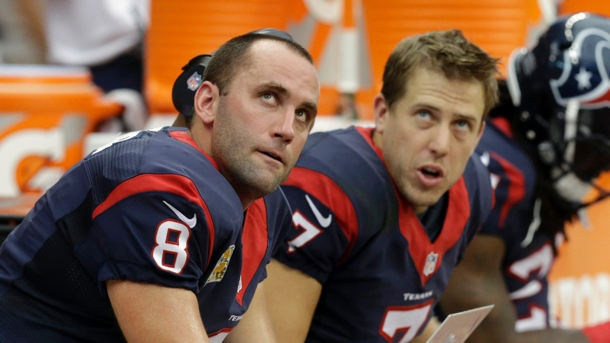 Houston Texans' Matt Schaub (8) and Case Keenum (7) look up at the scoreboard during the second half of an NFL football game against the Oakland Raiders Sunday, Nov. 17, 2013, in Houston. (AP Photo/Patric Schneider)