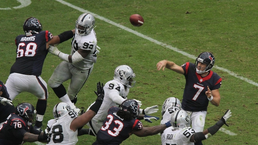 Houston Texans quarterback Case Keenum (7) throws under pressure during the second half of an NFL football game against the Oakland Raiders, Sunday, Nov. 17, 2013, in Houston. Oakland defeated Houston 28-23. (AP Photo/The Courier, Jason Fochtman)
