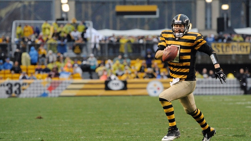 Pittsburgh Steelers quarterback Ben Roethlisberger (7) scrambles towards the end zone but comes up short in the third quarter of an NFL football game against the Detroit Lions on Sunday, Nov. 17, 2013, in Pittsburgh. (AP Photo/Don Wright)