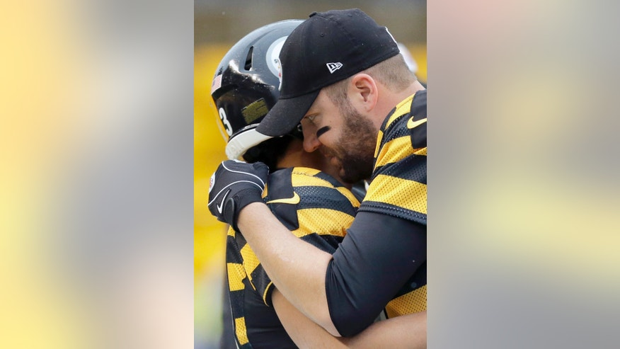 Pittsburgh Steelers quarterback Ben Roethlisberger, right, hugs strong safety Troy Polamalu (43) before an NFL football game against the Detroit Lions in Pittsburgh, Sunday, Nov. 17, 2013. (AP Photo/Gene J. Puskar)