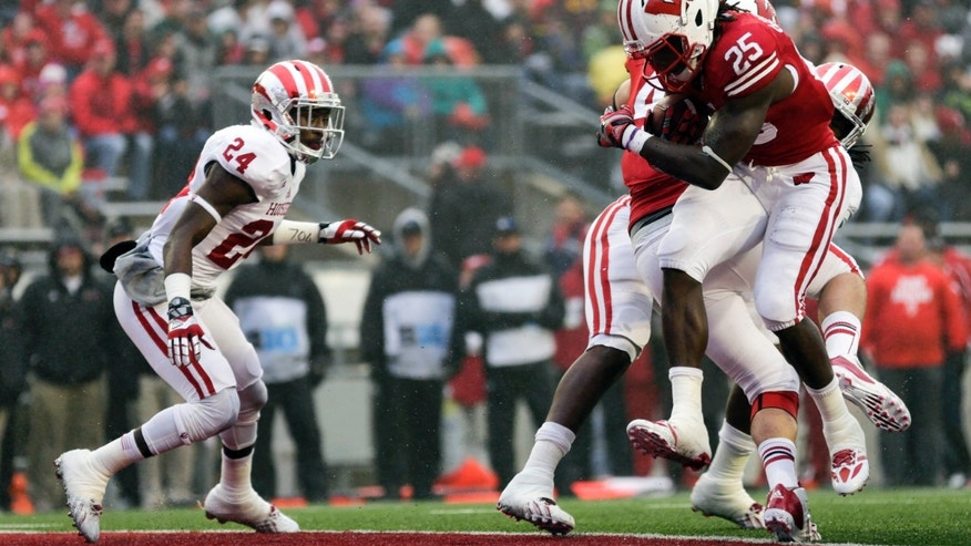 Wisconsin's Melvin Gordon scores a touchdown against Indiana's Tim Bennett (24) during the first half of an NCAA college football game Saturday, Nov. 16, 2013, in Madison, Wis. (AP Photo/Andy Manis)