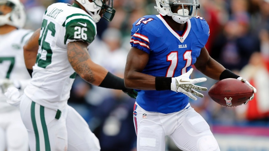 Buffalo Bills wide receiver T.J. Graham (11) scores on a touchdown reception in front of New York Jets strong safety Dawan Landry (26) during the first half of an NFL football game on Sunday, Nov. 17, 2013, in Orchard Park, N.Y. (AP Photo/Gary Wiepert)