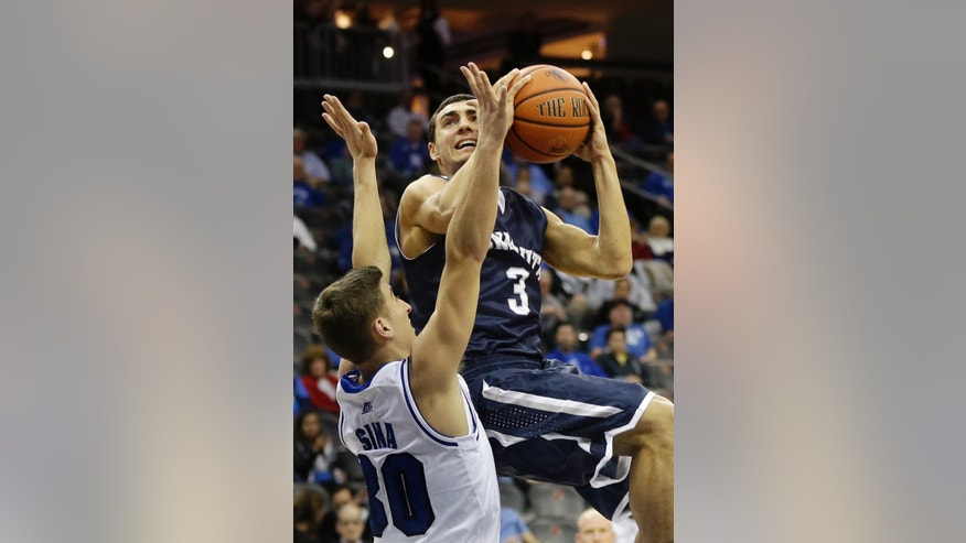 Monmouth guard Max DiLeo (3) takes a shot past Seton Hall guard Jaren Sina (30) during the first half of an NCAA college basketball game in Newark, N.J., Monday, Nov. 18, 2013. (AP Photo/Mel Evans)