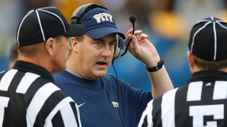 Pittsburgh head coach Paul Chryst, center, talks with field judge Mike Cullen, right, and line judge Richard Misner in the fourth quarter of an NCAA football game on Saturday, Nov. 16, 2013, in Pittsburgh. North Carolina won 34-27. (AP Photo/Keith Srakocic)