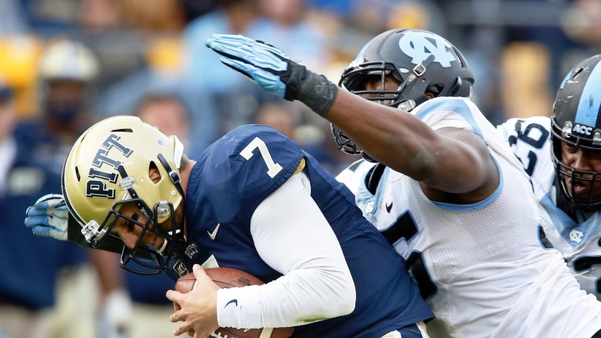 North Carolina defensive end Kareem Martin, right, sacks Pittsburgh quarterback Tom Savage (7) in the second quarter of an NCAA college football game on Saturday, Nov. 16, 2013, in Pittsburgh. (AP Photo/Keith Srakocic)