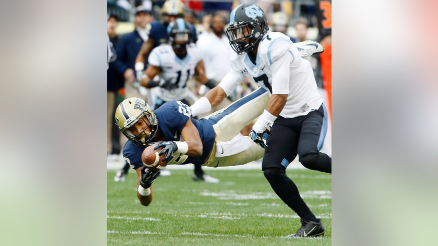 Pittsburgh wide receiver Tyler Boyd (23) dives to make a catch for a first down in front of North Carolina cornerback Tim Scott (7) duringn the first quarter of an NCAA football game, Saturday, Nov. 16, 2013 in Pittsburgh. (AP Photo/Keith Srakocic)