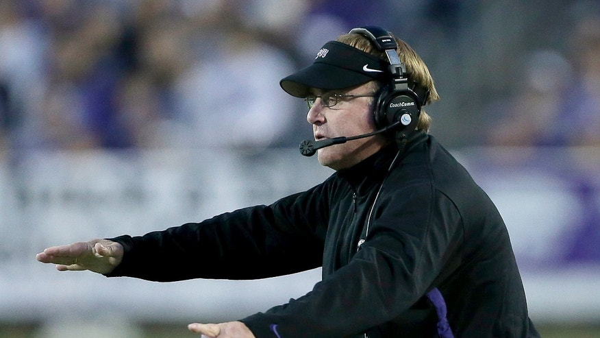 TCU coach Gary Patterson motions to his team during the second half of an NCAA college football game against Kansas State, Saturday, Nov. 16, 2013, in Manhattan, Kan. Kansas State won 33-31. (AP Photo/Charlie Riedel)