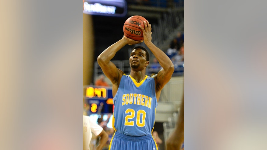 Southern University forward Calvin Godfrey (20) shoots a free throw during the second half of an NCAA college basketball game Monday, Nov. 18, 2013 in Gainesville, Fla. Godfrey scored a game high 20 points but it wasn't enough as Florida took the win 67-53.  (AP Photo/Phil Sandlin)