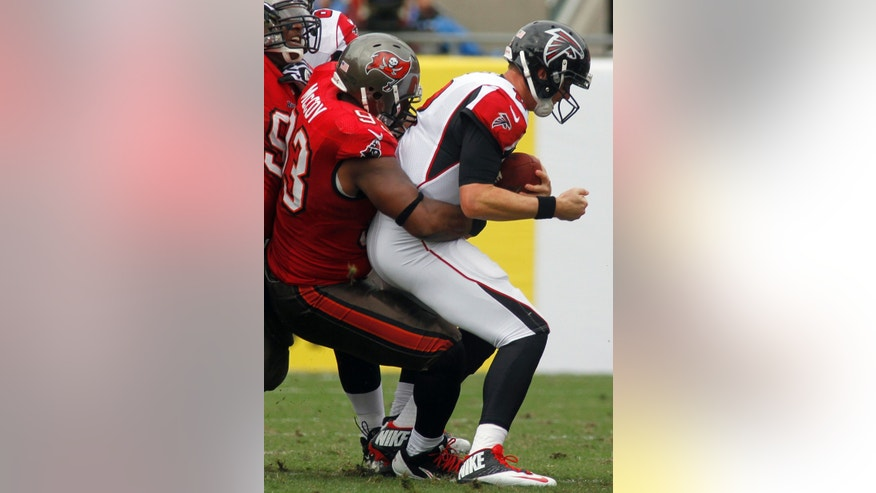 Tampa Bay Buccaneers defensive tackle Gerald McCoy (93) sacks Atlanta Falcons quarterback Matt Ryan (2) during the first quarter of an NFL football game on Sunday, Nov. 17, 2013, in Tampa, Fla. (AP Photo/Reinhold Matay)