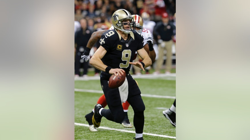 New Orleans Saints quarterback Drew Brees (9) scrambles under pressure from San Francisco 49ers outside linebacker Ahmad Brooks (55) in the first half of an NFL football game in New Orleans, Sunday, Nov. 17, 2013. (AP Photo/Bill Haber)