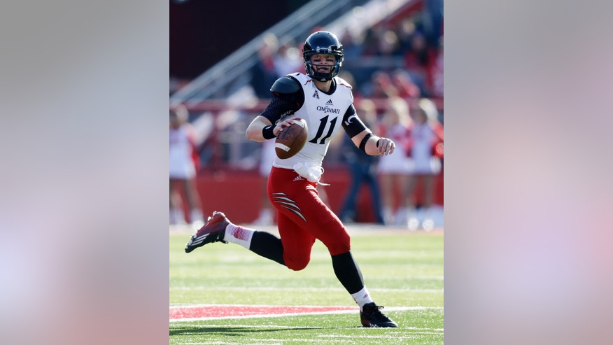Cincinnati quarterback Brendon Kay (11) looks to throw a pass during the first half of an NCAA college football game against Rutgers in Piscataway, N.J., Saturday, Nov. 16, 2013.   (AP Photo/Mel Evans)