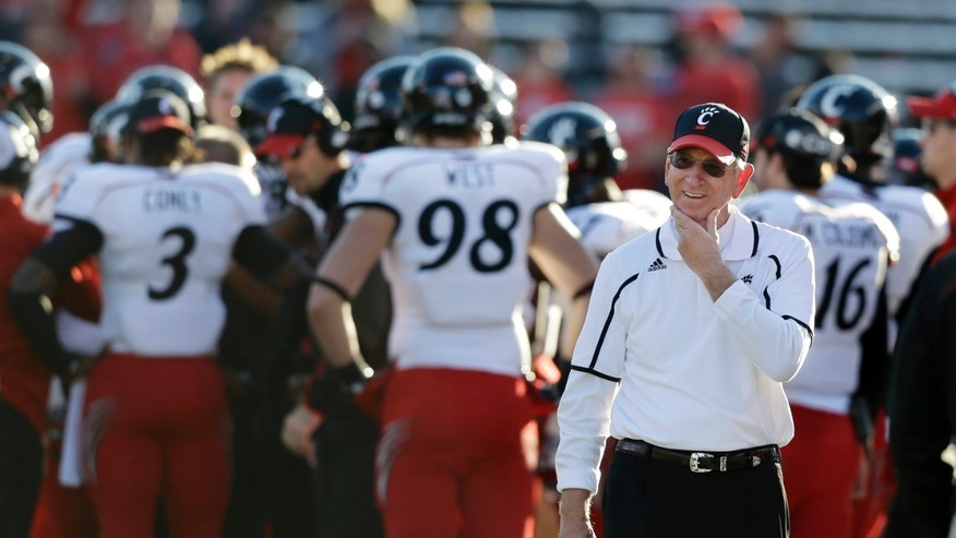 Cincinnati head coach Tommy Tuberville walks along the sidelines during the second half of an NCAA college football game against Rutgers in Piscataway, N.J., Saturday, Nov. 16, 2013. Cincinnati won 52-17. (AP Photo/Mel Evans)