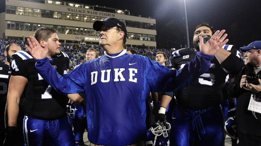 Duke coach David Cutcliffe celebrates an NCAA college football game against Miami in Durham, N.C., Saturday, Nov. 16, 2013. Duke won 48-30. (AP Photo/Gerry Broome)